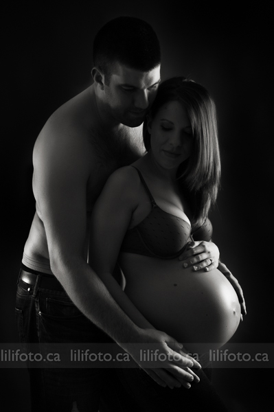 Pregnant couple silhouette in studio